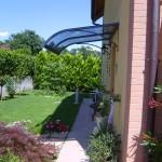 tettoia-pensilina-curva-plexiglas-compatto-copertura-entrata-certificata-tuv-design-azzate-varese-1a