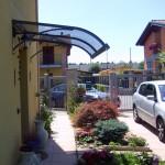 tettoia-pensilina-curva-plexiglas-compatto-copertura-entrata-certificata-tuv-design-azzate-varese-1b