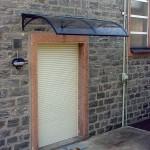 tettoia-pensilina-curva-plexiglas-compatto-copertura-entrata-certificata-tuv-design-azzate-varese-23