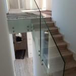 ringhiera-parapetto-scala-vetro-boccole-acciaio-inox-aisi-304-design-moderno-varese-azzate-7a